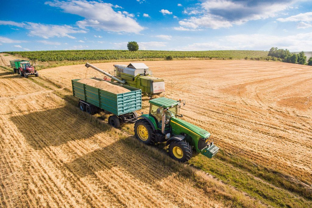 combine harvester pouring grain into trailer towed by tractor free stock photos picjumbo DJI 0118 2210x1473